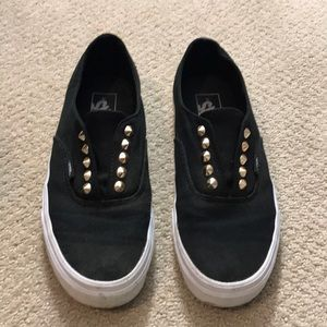 Black and gold studded vans